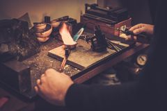 Goldsmith melting gold to liquid state. Stock Images