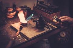 Goldsmith melting gold to liquid state. Stock Image
