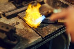 Goldsmith melting metal Royalty Free Stock Images
