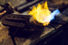 Goldsmith melting metal. To liquid state Stock Photo