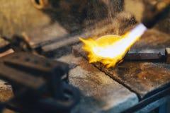 Goldsmith melting metal Royalty Free Stock Photography