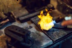 Goldsmith melting metal Royalty Free Stock Photos
