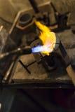 Goldsmith melting metal Stock Photos