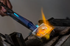 Goldsmith melting Silver Grains in crucible Stock Photo