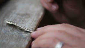 Goldsmith Polishing Bronze Pendant with Grinder stock footage