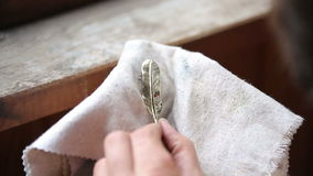 Goldsmith Polishing Bronze Pendant with Hands stock video footage