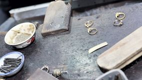 Goldsmith`s bench with some golden rings in process. Selectived focus Royalty Free Stock Images