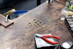 Goldsmith`s bench with some golden rings in process - selectived. Focus Royalty Free Stock Images