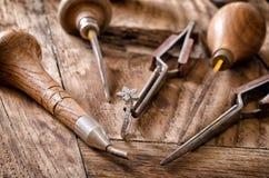 Goldsmith's tools. Still life of goldsmith's tools with diamonds ring Royalty Free Stock Photos