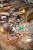 Goldsmith tools. And rings on the goldsmith workplace, desktop Royalty Free Stock Photography