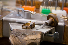 Goldsmith tools. And rings on the goldsmith workplace, desktop Royalty Free Stock Photo