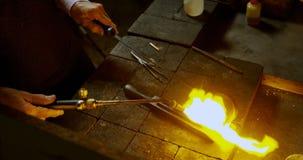 Goldsmith using welding torch in workshop 4k
