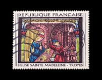 Goldsmith at work. France - circa 1967: Mail stamp representation of The Goldsmith At Work from the 16th century stained glass of Saint Madeleine, Troyes Royalty Free Stock Images