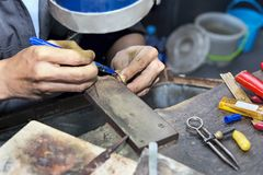 Goldsmith at work with traditional tools. Selectived focus Stock Image