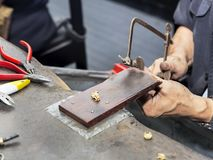 Goldsmith at work with traditional tools. Selectived focus Royalty Free Stock Images