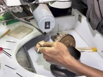 Goldsmith at work with traditional tools. Selectived focus Royalty Free Stock Photos