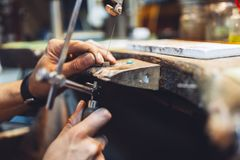 Goldsmith working. And creating jewelry Royalty Free Stock Images