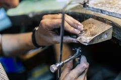 Goldsmith working. And creating jewelry Stock Photo