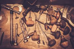 Goldsmiths tools on the goldsmith workplace. Stock Image