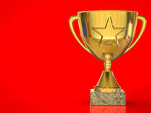 Goldsterntrophäe auf rotem Hintergrund Lizenzfreies Stockfoto