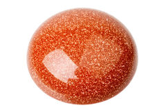 Goldstone cabochon. One copper red glittering Goldstone cabochon isolated on white Royalty Free Stock Image