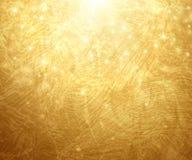 Goldstrukturierter Hintergrund Auch im corel abgehobenen Betrag Stockfotos