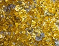 Schrotte der Goldfolie Stockbild