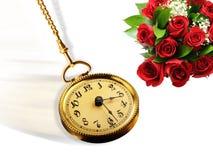 Goldtaschen-Uhr und Rosen Stockfoto