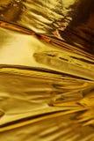 Goldtiefer Beschaffenheitshintergrund mit hoher Dichte Stockfoto