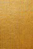 Goldwandhintergrund Stockfoto