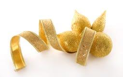 Goldweihnachtsdekorationen lizenzfreies stockbild