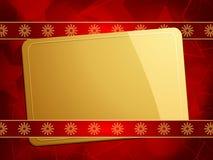 Goldweihnachtsgeschenkkarte auf einem roten Hintergrund Lizenzfreie Stockfotografie