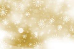 Goldweihnachtshintergrund von Schneeflocken und von Sternen Stockbilder