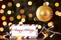 Goldweihnachtsverzierung und glückliche Feiertags-Karte Stockbilder