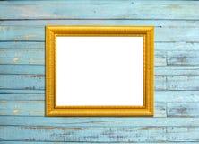 Goldweinlese-Bilderrahmen auf blauem hölzernem Hintergrund Stockfotos