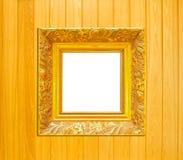 Goldweinlese-Bilderrahmen auf hölzernem Hintergrund Stockfotografie
