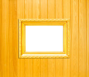 Goldweinlese-Bilderrahmen auf hölzernem Hintergrund Lizenzfreies Stockfoto