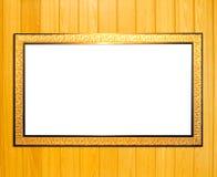Goldweinlese-Bilderrahmen auf hölzernem Hintergrund Stockfotos