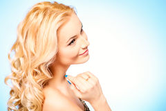 Goldy blonde. Portrait of a happy beautiful blonde woman smiling at camera. Body care. Spa Royalty Free Stock Images