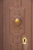 Goldy doorknob on wood Royalty Free Stock Photo