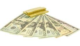 Goldziegelsteine auf Banknote Stockfotos