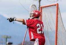Goleiros da lacrosse que dá comandos Foto de Stock