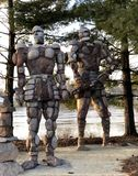 Golems protecting the Rock River. This is a Winter picture of two of the four golems titled the Rockmen Guardians located along the Rock River in Sinnissippi Royalty Free Stock Image