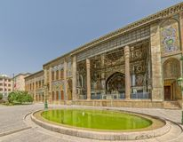 Golestan Palace exterior. With green pool, former royal Qajar complex in capital city. Tehran, Iran Royalty Free Stock Photo