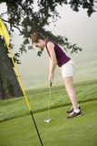 Golf. Model Release 353 Woman in her mid 20s playing golf stock image