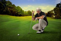 Golf. Player controlling a shot in a  club Royalty Free Stock Photography