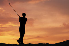 Golf. Male playing golf af dawn Royalty Free Stock Images