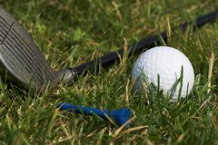 Golf. Equipment laid out on grass royalty free stock photos