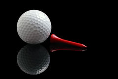Golf. Ball , tee on black background with reflection Stock Images