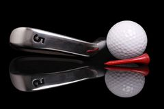 Golf. Ball , tee and club, 5 iron on black background with reflection Stock Photo